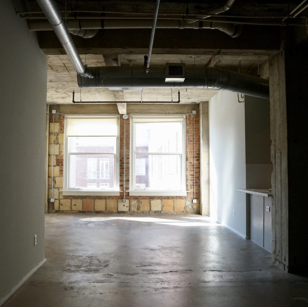 Exposed Brick Lofts In Downtown Dallas